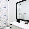 Black and White Bathroom With Framed Mirror