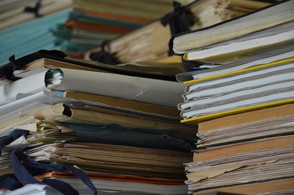 A pile of documents in folders