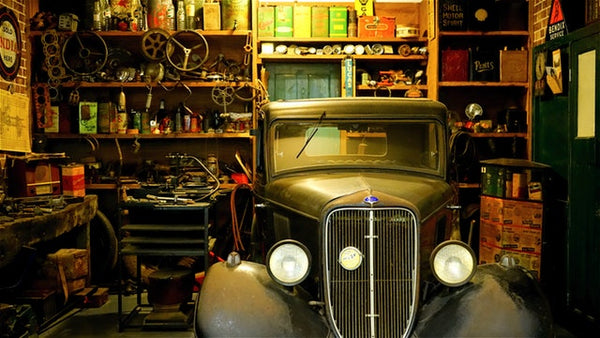 Full garage with old car