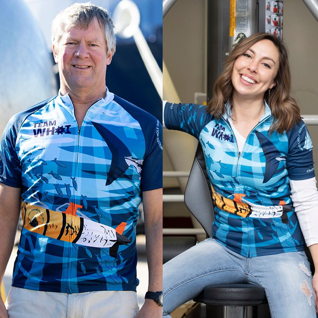 man on left and woman on right wearing SharkCam cycling shirt