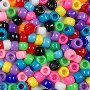 An assortment of opaque colors of 6 x 9mm Plastic Pony Beads
