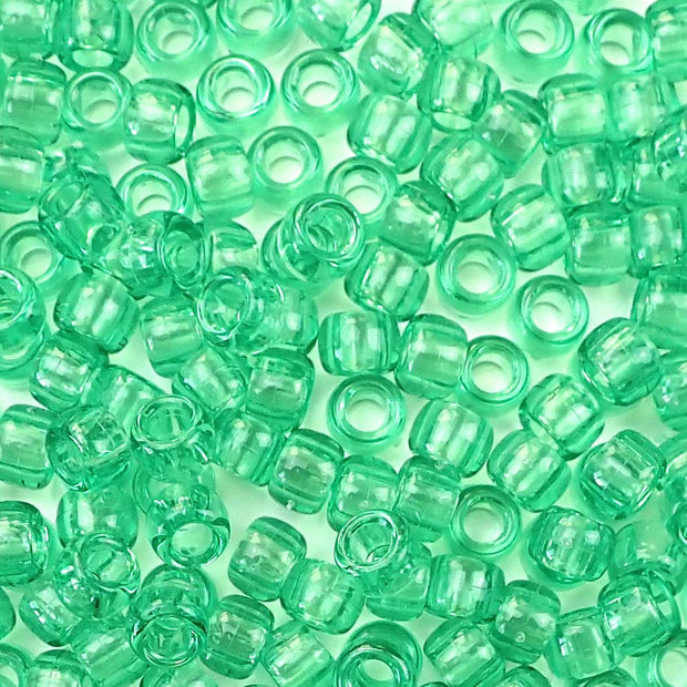 transparent peridot green 6 x 9mm plastic pony beads in bulk