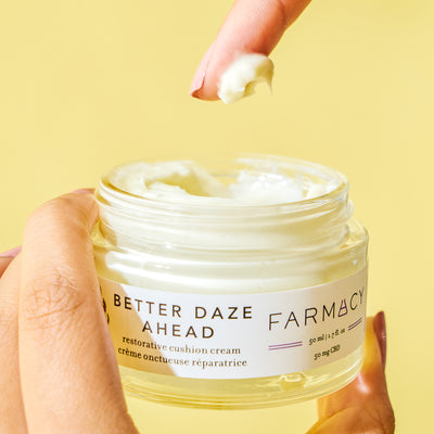 Finger dipping into Better Daze Ahead moisturizer