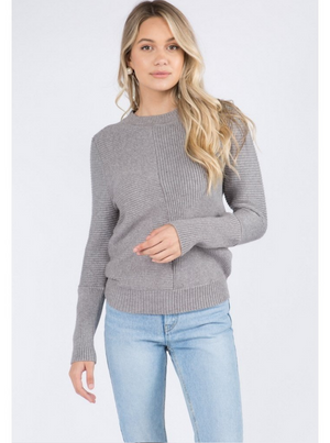 signature knit sweater with long sleeves.