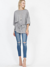 grey solid top, has a tied waist that adding flattering shape to this relaxed dolman top.