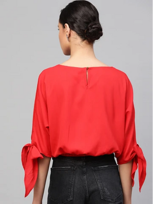 solid crop top with button closure, kimono styled elbow sleeves, round neck.