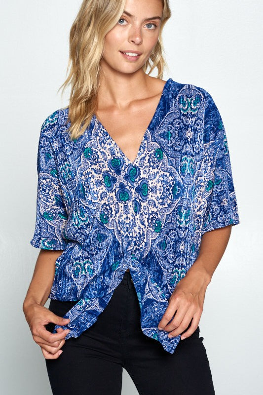 PRINT SHORT SLEEVE TOP WITH BUTTONS AND TIE