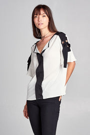 WHITE TOP WITH BLACK TRIM AND TIE DETAIL