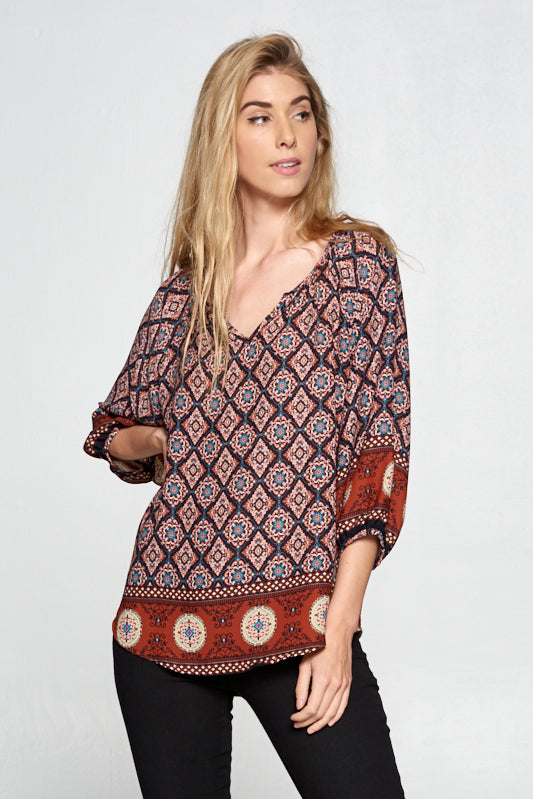 RUST BORDER PRINT V-NECK TOP