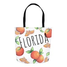 Load image into Gallery viewer, Florida orange tote bag with orange fruit designs all over and the word 'Florida' across