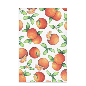 orange kitchen towel with citrus fruit oranges all over
