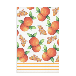 orange kitchen towel with citrus fruit oranges and slices all over with light orange lines on bottom