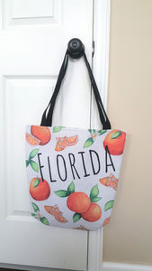 Florida orange tote bag with orange fruit designs all over and the word 'Florida' across