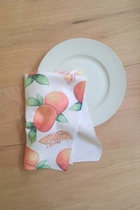 orange kitchen towel with citrus fruit oranges and slices all over