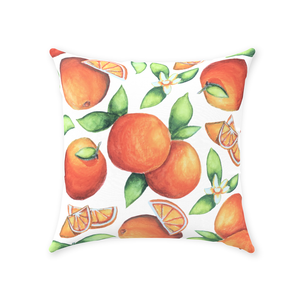 Orange throw pillow with fruit designs all over