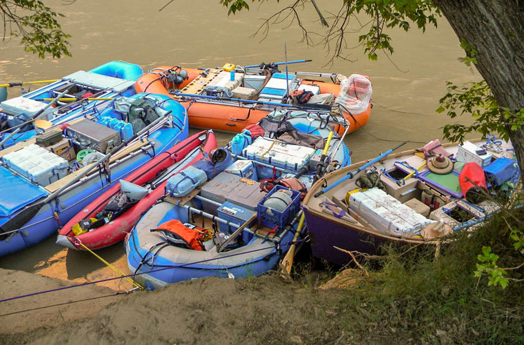 rafts tied up at river side
