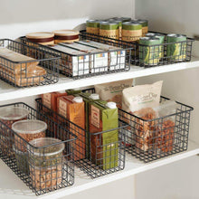 Load image into Gallery viewer, Discover the mdesign farmhouse decor metal wire food storage organizer bin basket with handles for kitchen cabinets pantry bathroom laundry room closets garage 16 x 6 x 6 8 pack bronze