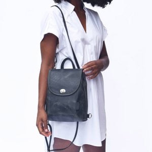Backpack Leather Circuit transforms from a small backpack to a cross-body design.