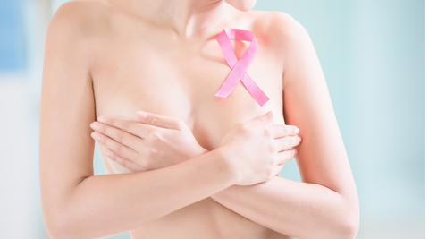 woman holding her breasts, pink ribbon