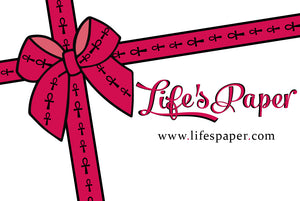 Hot pink ribbon with bow tie, small black ankh symbols patterned on the ribbon; Life's Paper title in pink script lettering, website under title