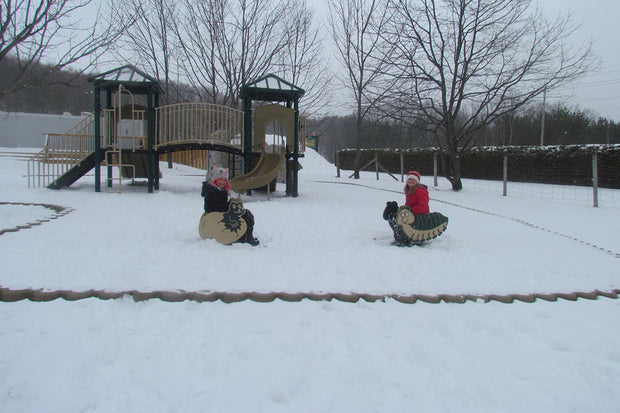 Children playing at the playground in the winter - Scenic Caves Nature Adventures - Collingwood