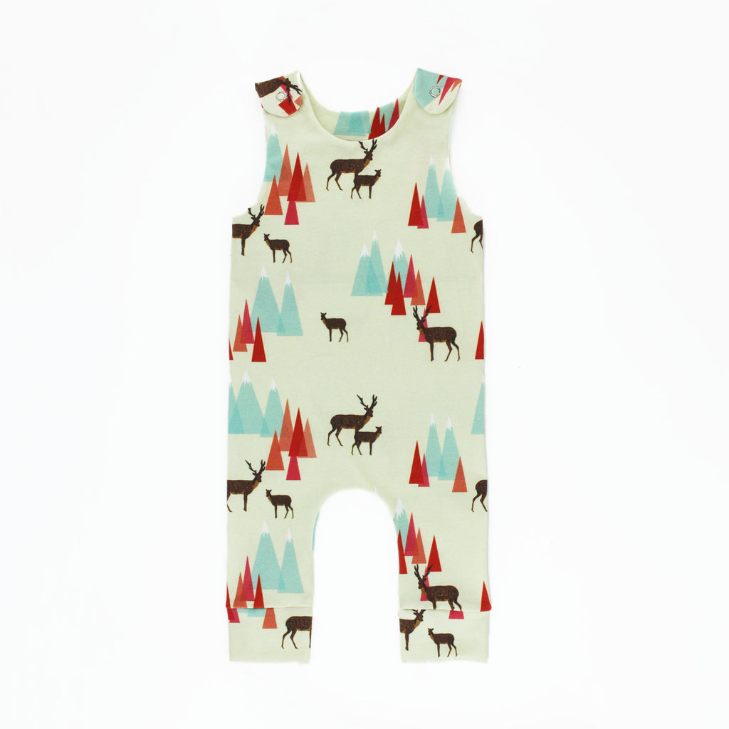 Woodland Romper Sewing Pattern sewn in a mountain and deer print