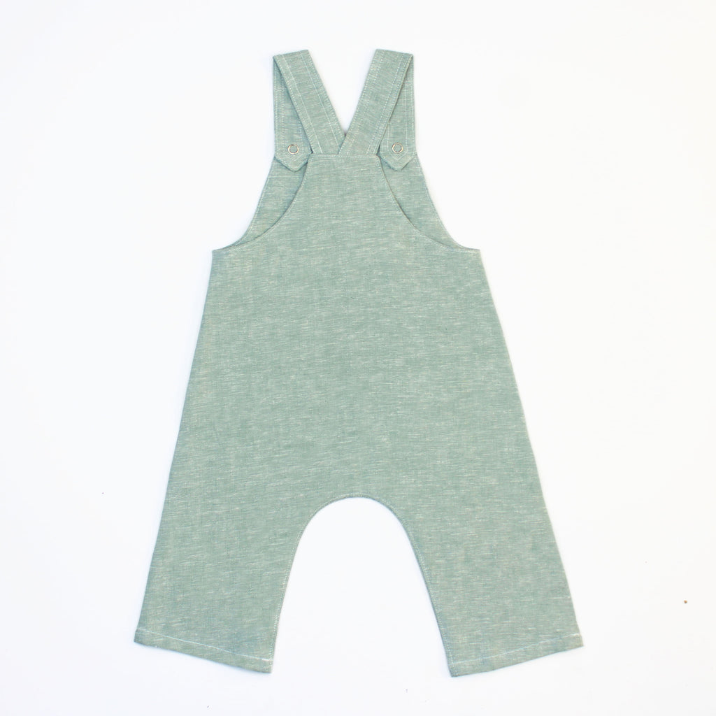 back of green linen woven overalls on white background