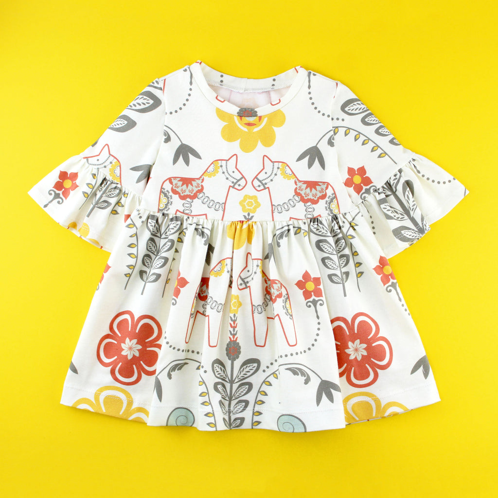 Bell Sleeve knit dress in floral dala horse fabric on yellow background