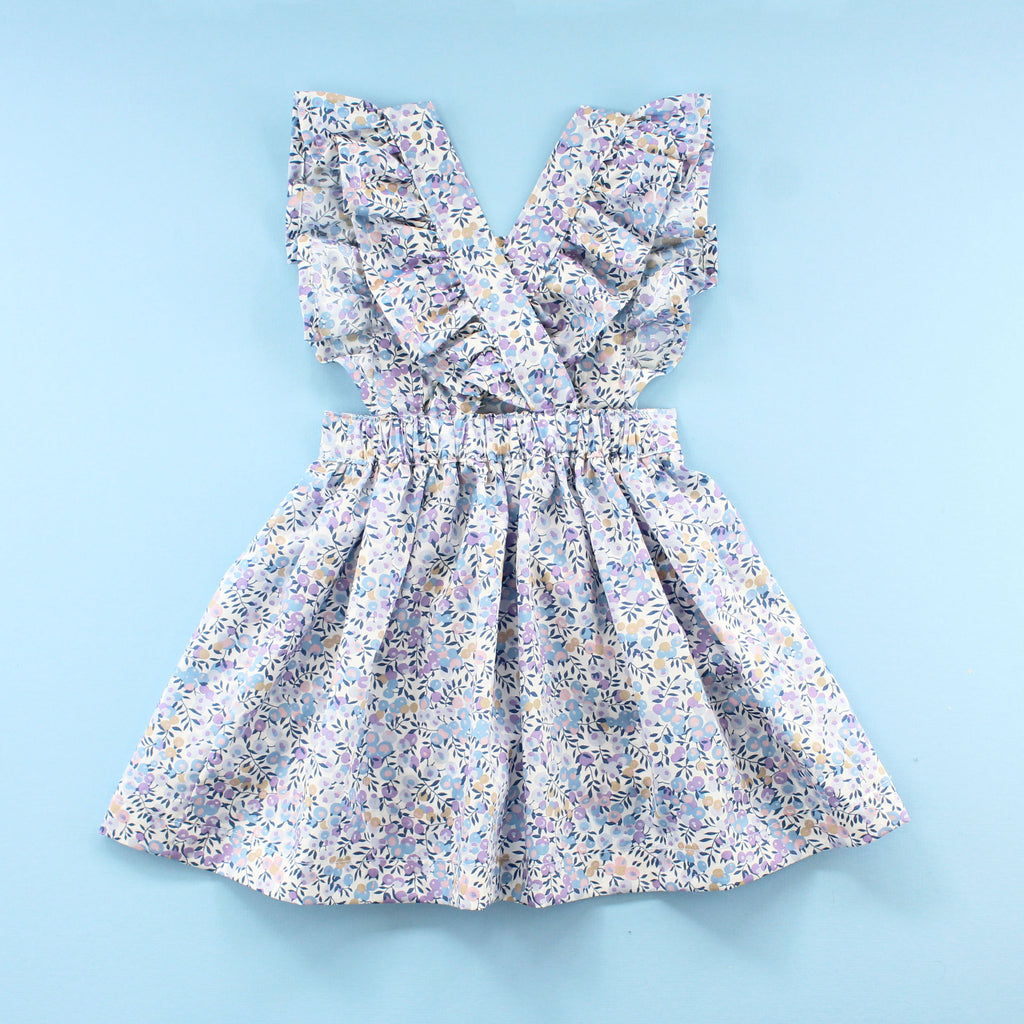 back of ruffle baby pinafore dress in blue liberty of london fabric