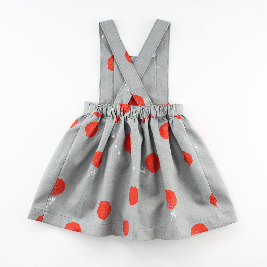 back of Baby Pinafore Dress in grey linen with red polka dots