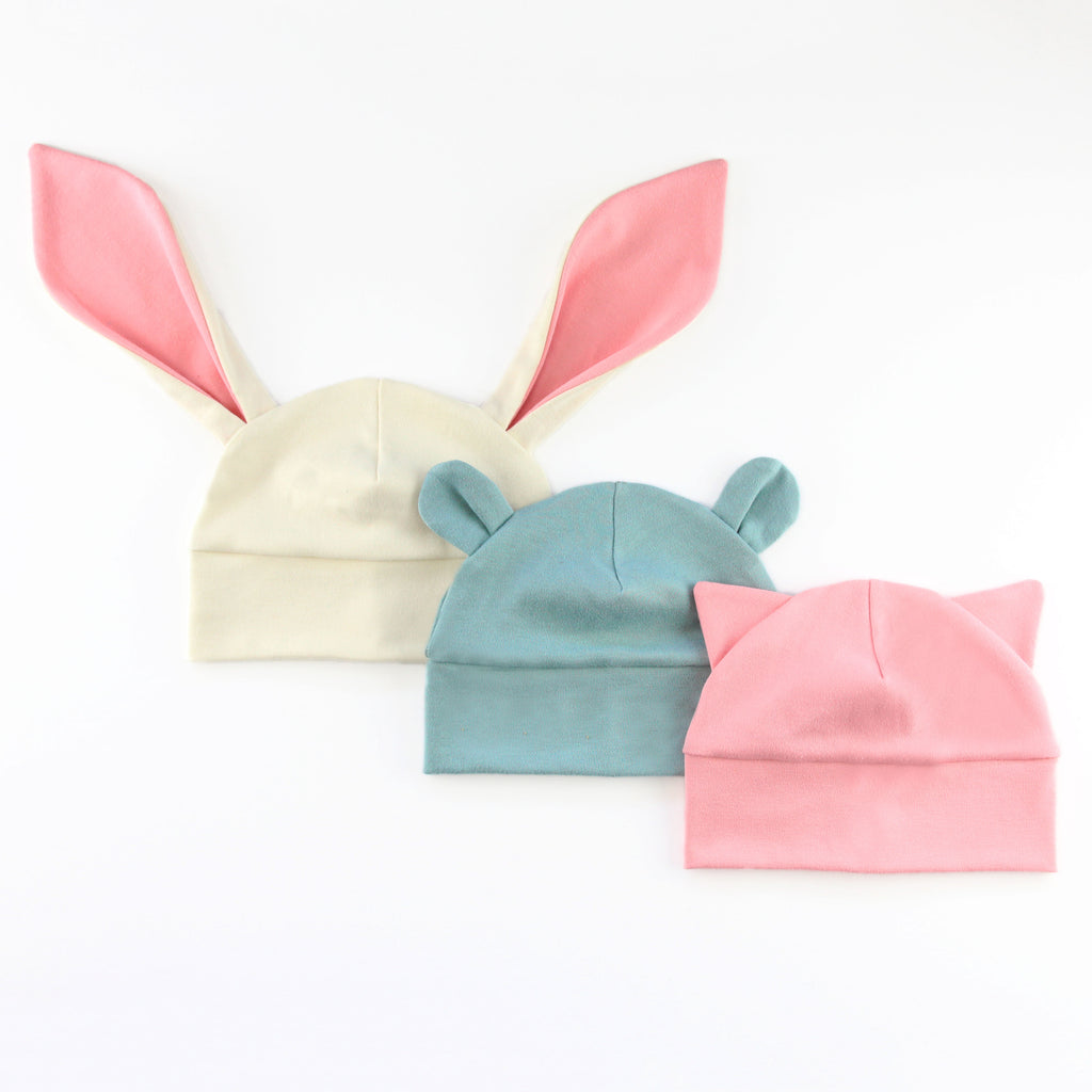 an array of baby hats with animal ears