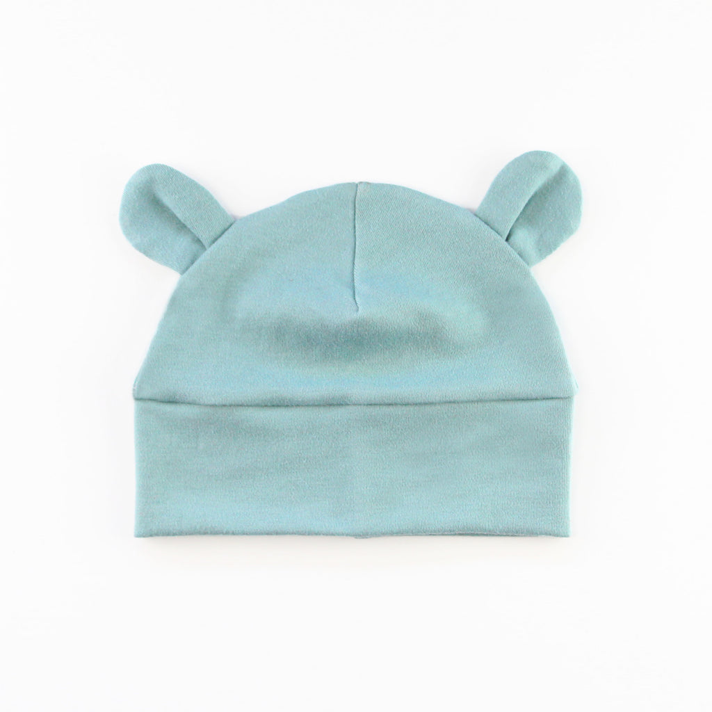 baby hat with bear ears in blue knit fabric