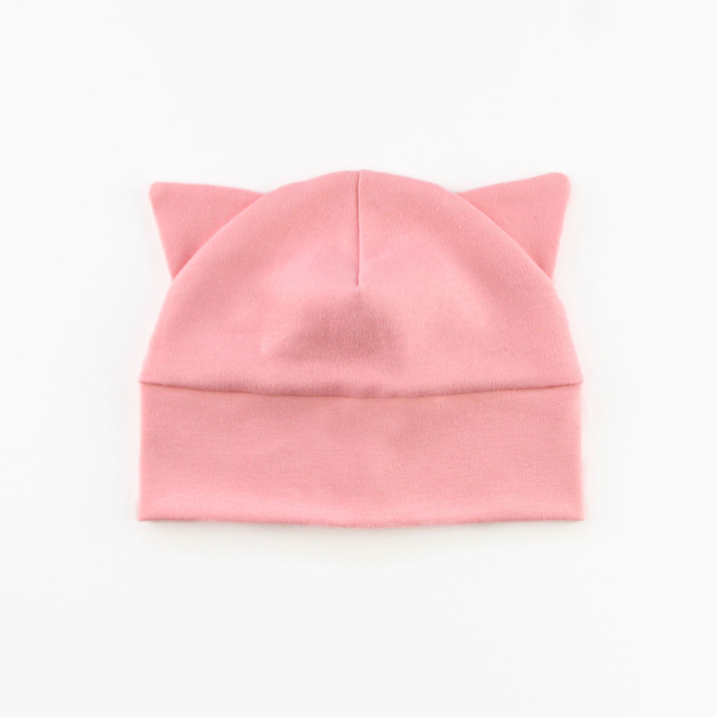 baby hat with cat ears in pink knit fabric