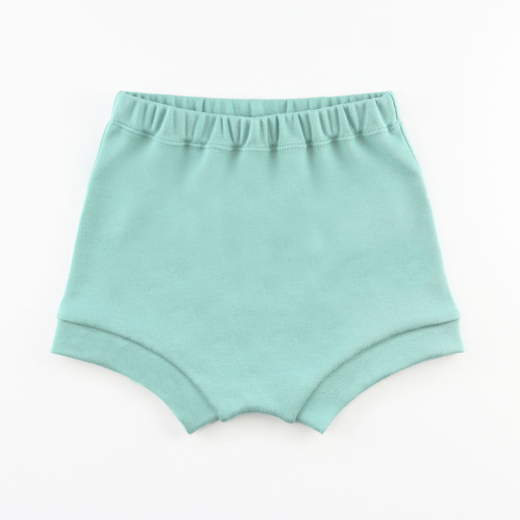 teal baby bummie shorts on a white background