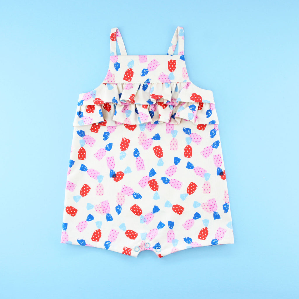Poppy Romper Playsuit with ruffles in a strawberry candy print fabric