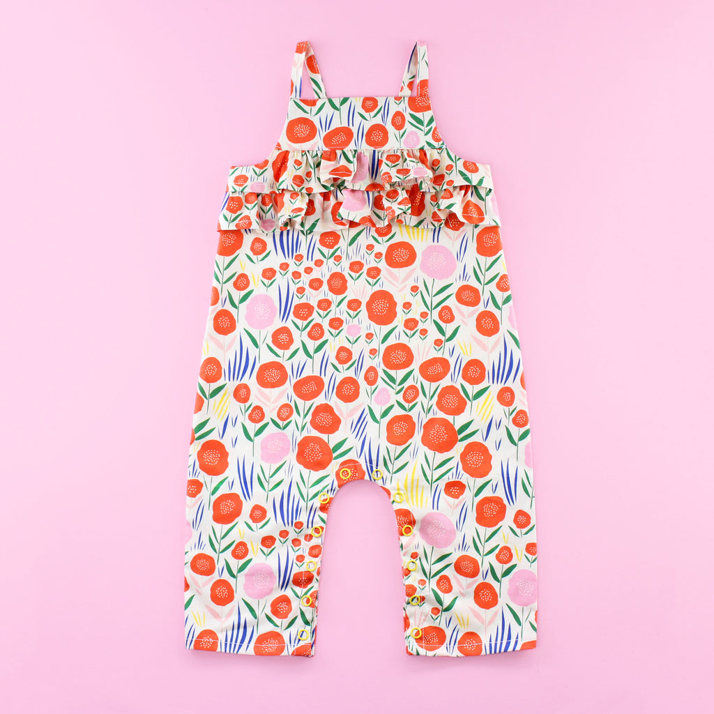 Poppy Romper Pattern with Ruffles and Snaps on Pink Background