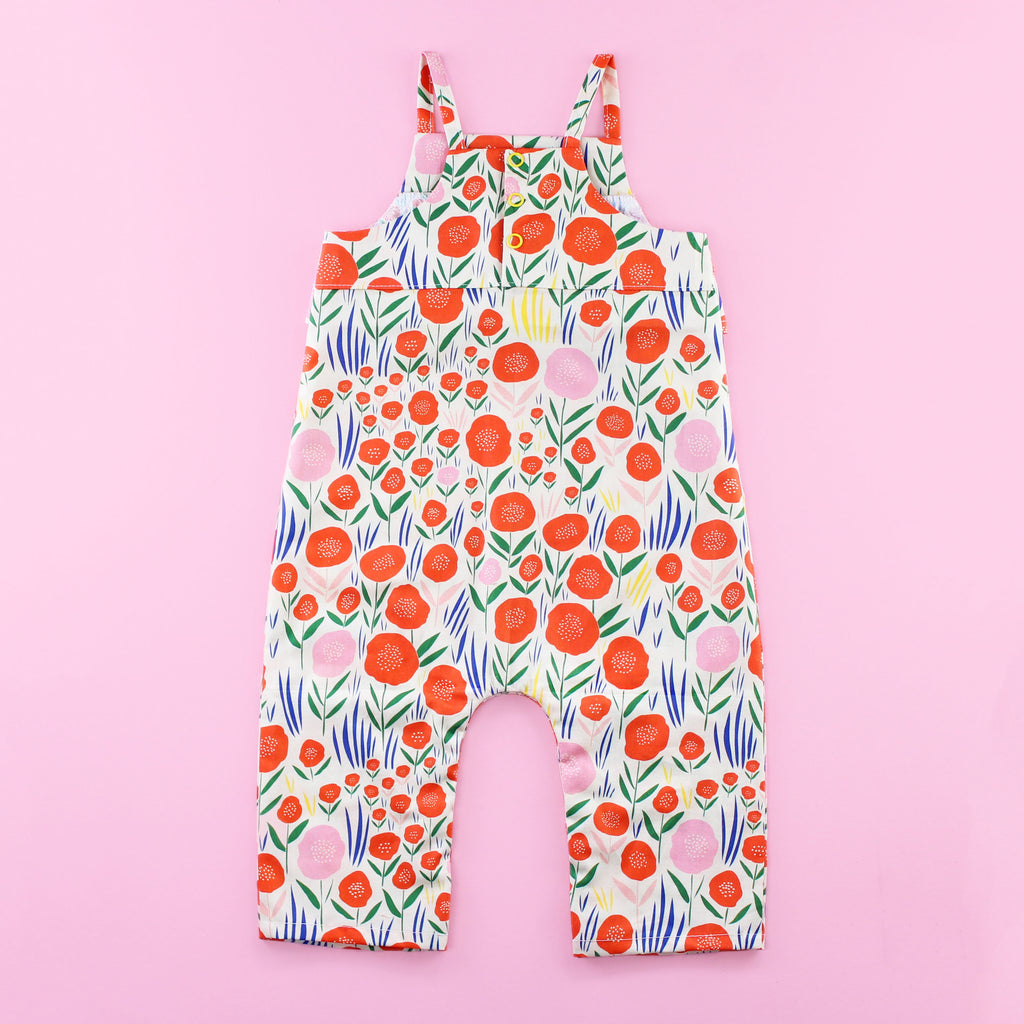 Back of Poppy Romper Pattern with Ruffles and Snaps on Pink Background