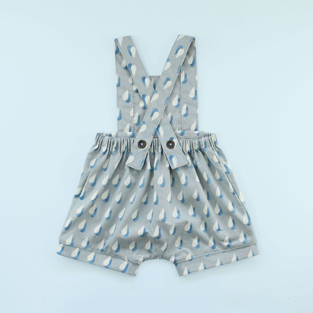 Back of Rainy Day Romper in raindrop print on blue background