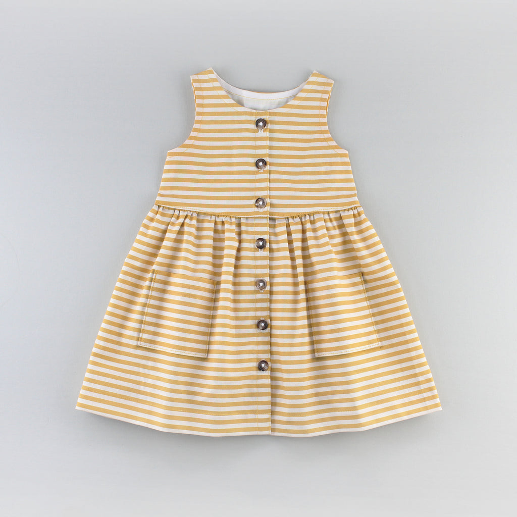 The Sunflower Dress Sewing Pattern in a Yellow Striped Fabric
