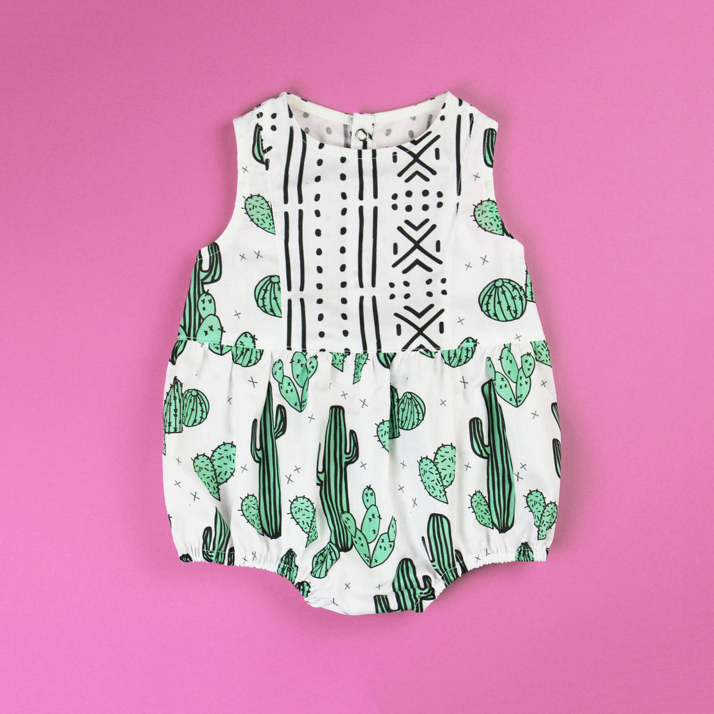 Cactus baby romper with contrast panel on fuchsia pink background