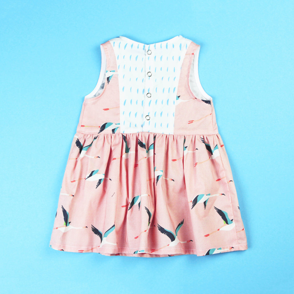 back of flamingo dress with snap up back