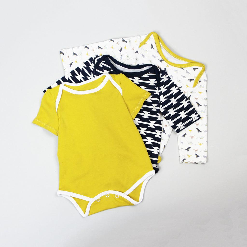 three baby onesies layered on top of each other