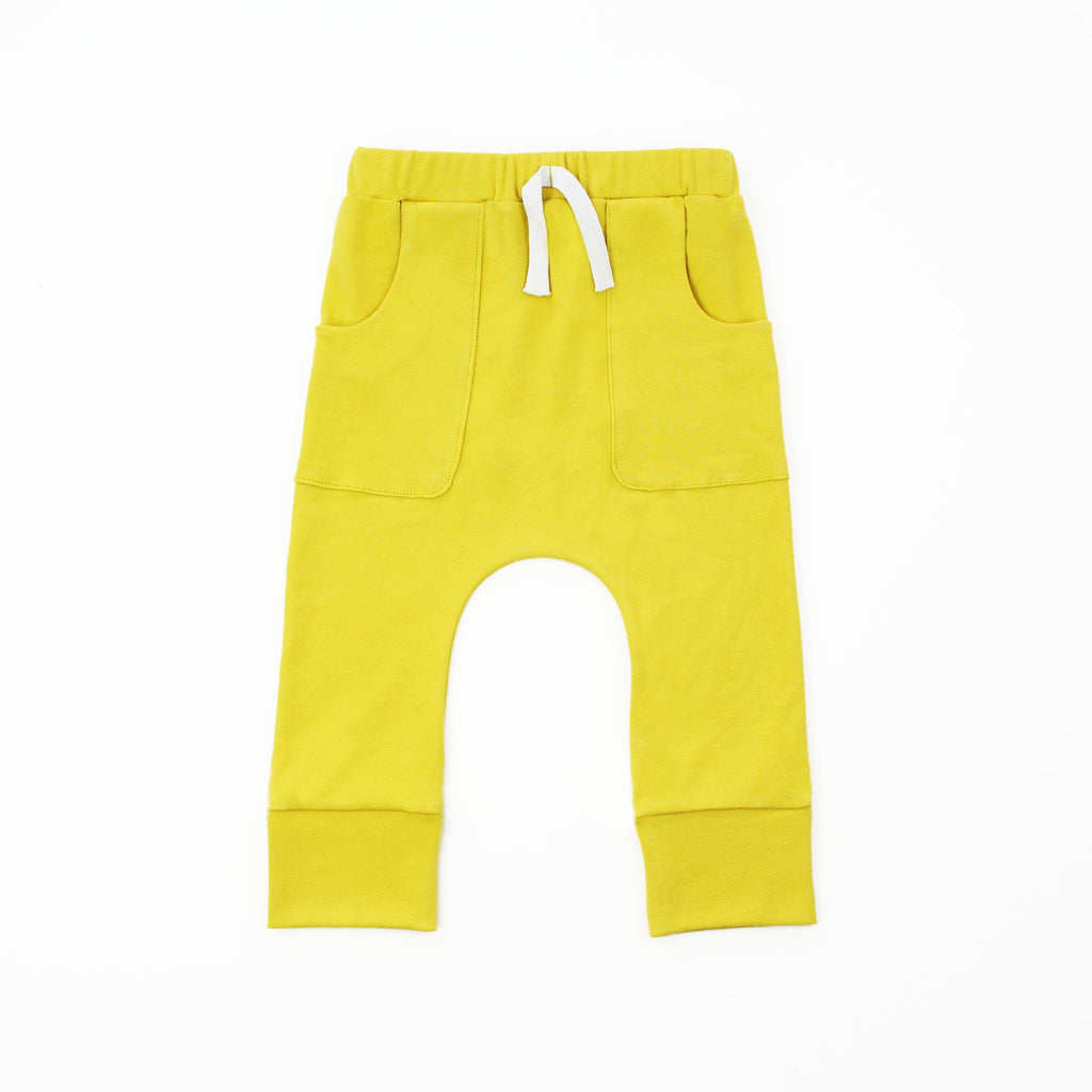 mustard yellow pocket joggers on a white background