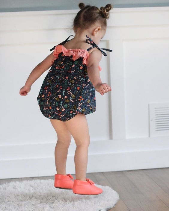 Girl Jumping in Her Bubble Romper and Pink Moccasins