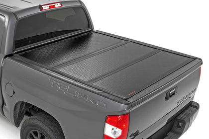 Rough Country Low Profile Tri-Fold Hard Bed Cover | 2002+ Toyota Tundra - TheYotaGarage