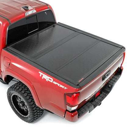 Rough Country Low Profile Tri-Fold Hard Bed Cover | 2016+ Toyota Tacoma - TheYotaGarage