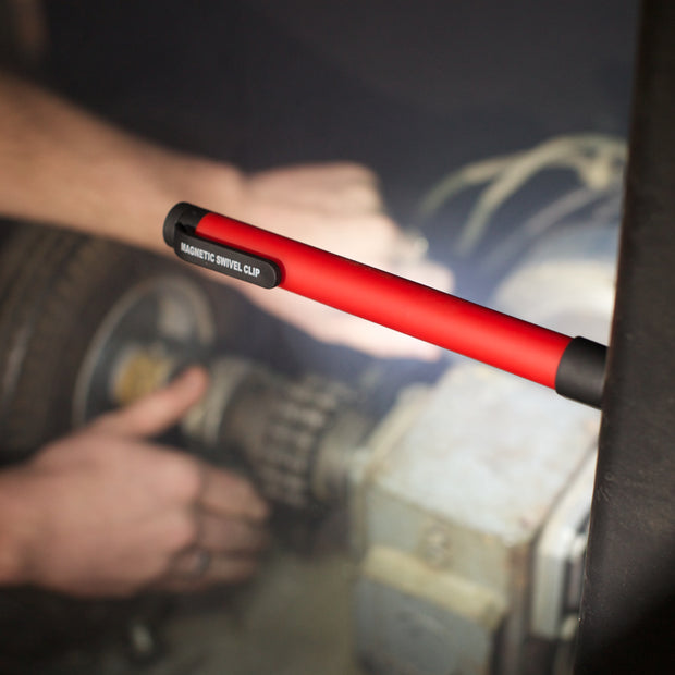Magnetic led flashlight in use by a mechanic.