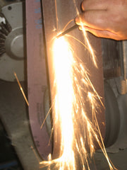 Sparks from flint rod.