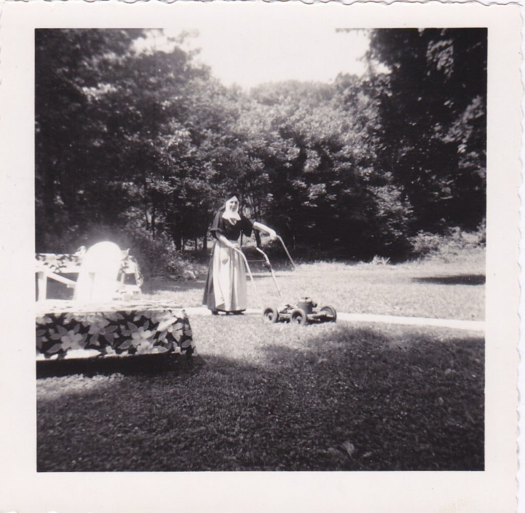 Nun Mowing Lawn Snapshot