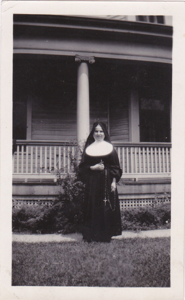 Nun with Rosary Snapshot